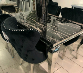 Brand new black marble dining table and 6 Knocker back chairs