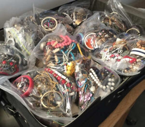 155 lbs of VINTAGE TO NEWER JEWELLERY.  Worth over $10K plus.