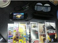 Sony PSP (black), case, charger and 7 games.