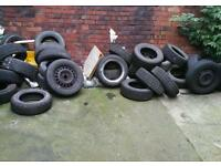 Stack of new and part worn tyres