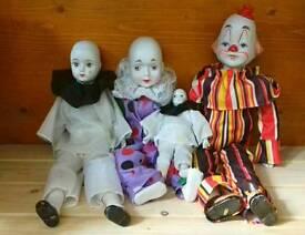 Four Porcelain/China Clown Dolls. Collectible