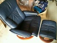 Blue leather recliner with foot stool
