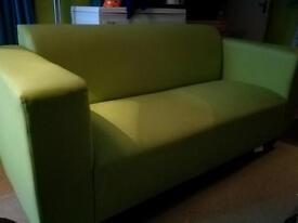 Modern green leatherette sofas