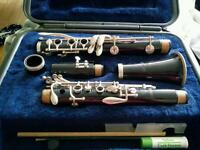 Clarinet with free stand and music books