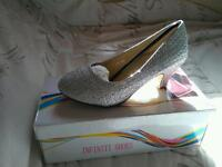 Brand new size 12 silver diamante shoes