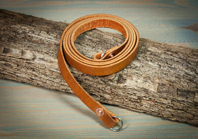 40in Hand made leather copper riveted camera strap with moveable shoulder pad.