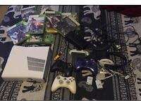 Xbox 360 slim gloss white (rare) with 16 games 3 controllers + extras