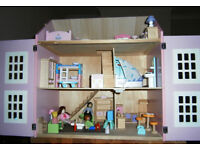 Very Lovely medium sized Pink wooden dolls house / Full of furniture and carpets