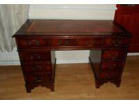 Regency Style Pedestal Desk - Burgundy Leather Top, Mahogany Veneer, 8 drawers , with keys.
