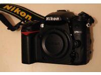 Nikon D7000 16MP with Nikon Power Grip.