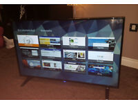 for sale a beatiful 43 inch Sharp SMART HD TV with WI FI ex display in mint condition with remote