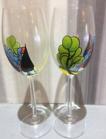 Pair of Clarice Cliffe design hand painted wine glasses