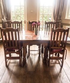 Heavy dark wood table with 5 chairs