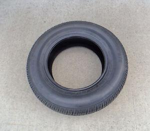 New 215-70R15 tire