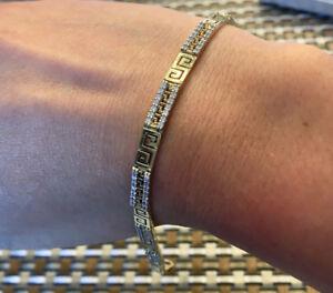 Versace bracelet or 10k zircons