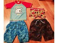 Boys swim shorts, top and three towels