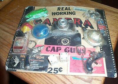 Vintage gumball machine display card 25c working camera mini gun etc. dc10