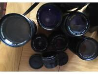 EIGHT CAMERA LENSES - sold as one lot.