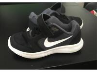 Kids size 10 black and white nike trainers