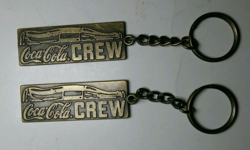 Lot of 2 Vintage Coca-Cola Crew Double Sided Keychains,