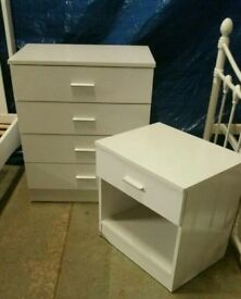 A brand new white finish 4 drawer chest and 1 drawer bedside table.