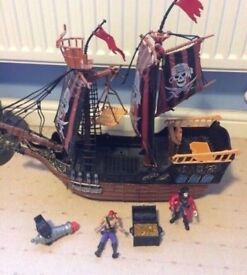 Pirate ship with treasure chest and figures