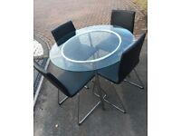 Glass table and 4black dining chairs