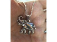 Steel elephant with silver plated chain.