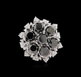 Brand new 10.51 carat, 14 ct white gold ring with 7 round black diamonds and 54 clear diamonds