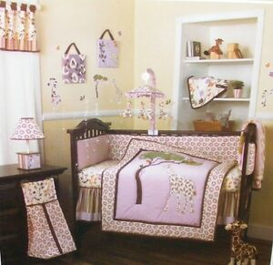 Giraffe bed setting with extra sheets, protector and wall deco.