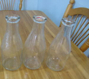 3 old milk bottles