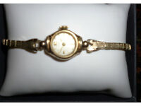 Ladies vintage Swiss Doxa 14k Solid Gold watch case and 10k gold filled bracelet