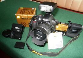 Nikon 3100 DSLR camera with Nikkor 18-55mm lens