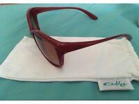 Oakley burgundy women's sunglasses, never been used