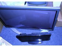 TVs two flat screen and one box TV