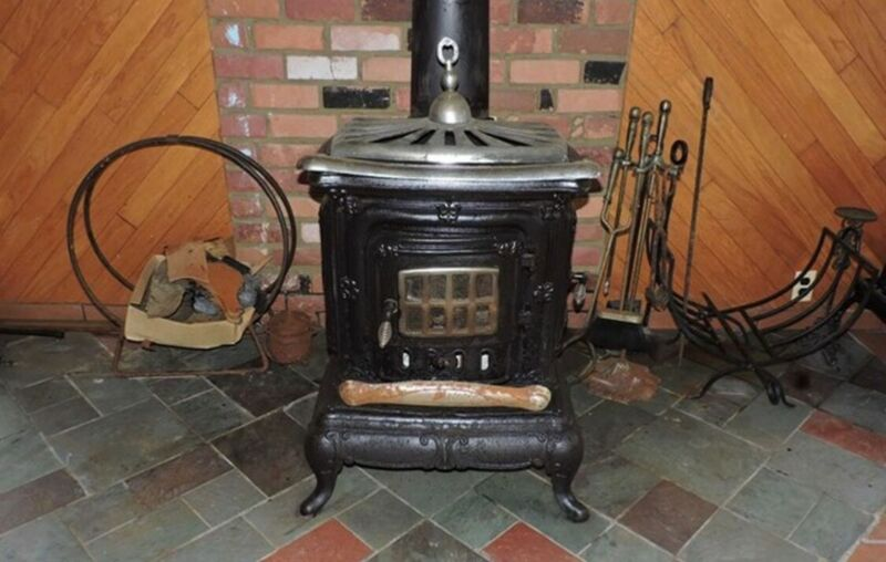 Cast iron wood burning heater/stove