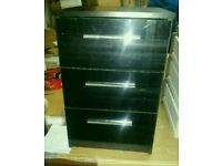 A brand new black finish 3 drawer bedside table with sparkling handles.