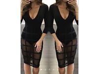Caged black dress