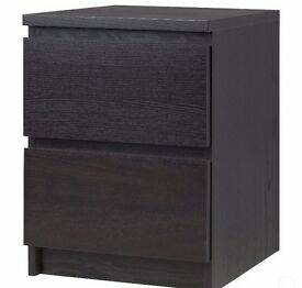 A pair of black/brown wooden bedside tables with two drawers one year old great condition