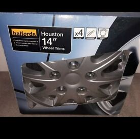 """Brand new in box 14"""" halfords wheel trims. Sold car before able to use them."""
