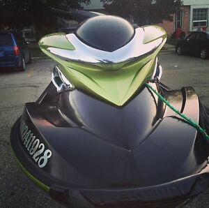 2004 rxp 1500 cc supercharged seadoo with trailer.