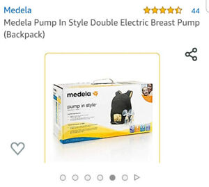 Medela pump, like new condition - in box