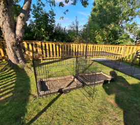 Two dog crate cage's as new with waterproof mattresses