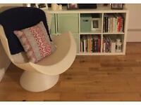 White matte IKEA Kallax shelving unit
