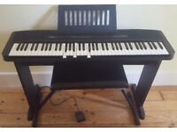 Casio CPS-7 digital piano keyboard and accessories