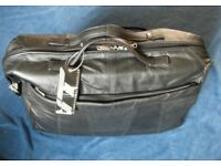 Black leather travel bag - as new with tags