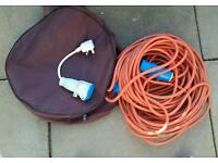 Caravan hook up cable and mains hook up.