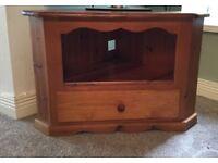 Corner pine TV unit with drawer.
