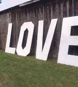 Large Love sign, sequin tablecloths chairs cover to rent