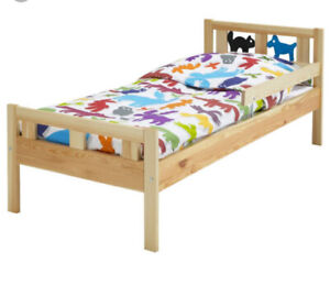 Kids bed with mattress.